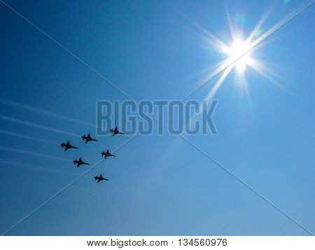 formation of six jets in blue sky and sun