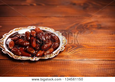 Beautiful Background With Dried Dates On A Silver Tray On Wooden Background.  The Muslim Feast Of Th