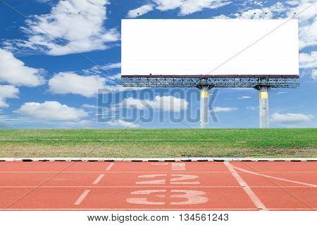 white digital billboard with running track in sport stadium blue sky background