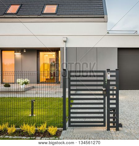 House With Decorative Fence