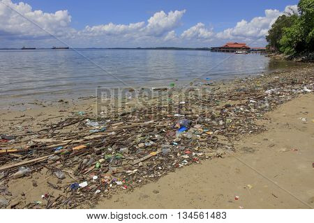 SANDAKAN, MALAYSIA - 16 JUNE 2016: Plastic garbage pollution on beach. Bottles and bags pollute the environment.