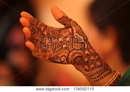Beautiful design with traditional patterns of henna or mehendi as it is called on the hand of an Indian bride.