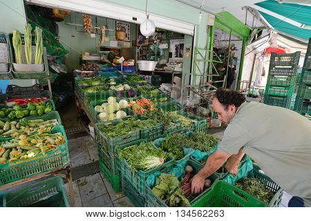 CRETE HERAKLION - AUGUST 09: Unknown people sell fresh vegetables in Heraklion Crete Greece on 09 August 2014. Heraklion the capital of the island of Crete Greece