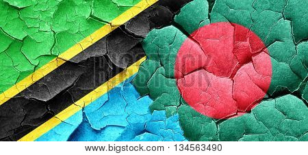 Tanzanian flag with Bangladesh flag on a grunge cracked wall