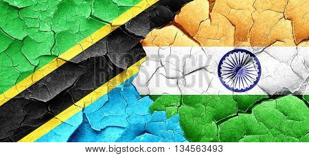 Tanzanian flag with India flag on a grunge cracked wall