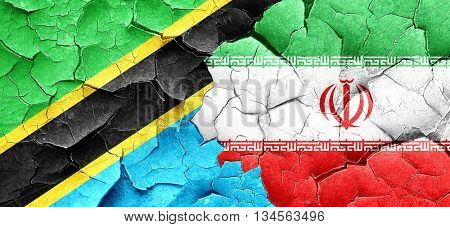 Tanzanian flag with Iran flag on a grunge cracked wall