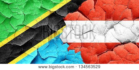 Tanzanian flag with Austria flag on a grunge cracked wall