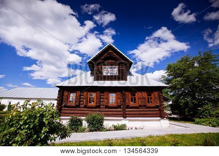 Facade Of The Old Russian Log Houses In Suzdal