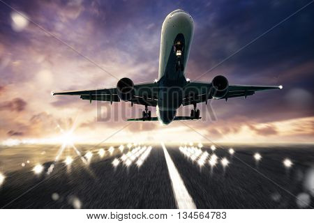 Aircraft taking off on a runway with sunlight