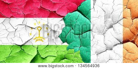 Tajikistan flag with Ireland flag on a grunge cracked wall