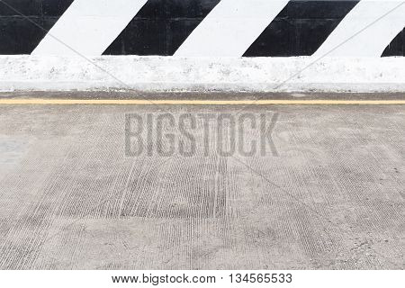 road barrier beside high way concrete road with traffic sign black and white color