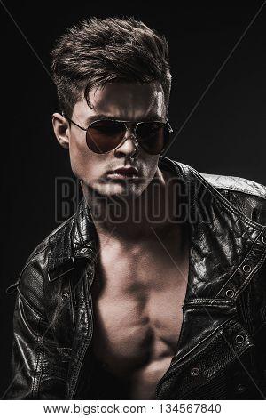 Athletic, male, model, brutal leather suit body bodybuilder posing