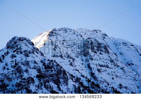 alps mountain views from Italy full of snow and skiers