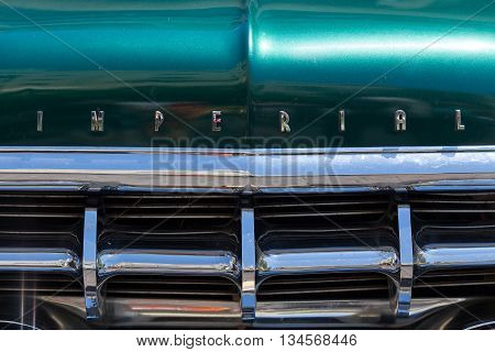Tel Aviv, Israel, June 12, 2016: Green Imperial with original emblem and front grill. Imperial was the Chrysler Corporation's luxury automobile brand between 1955 and 1975,