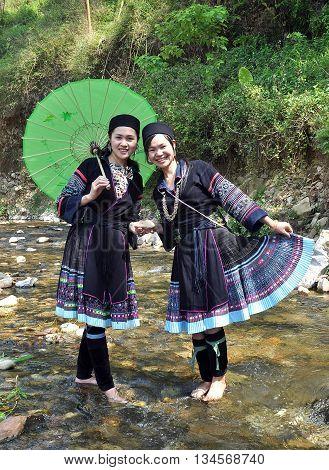 SAPA, VIETNAM, February 18, 2016 two ethnic Hmong girl, charming traditional costumes