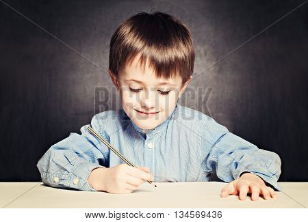 Small Boy Pupil Painting. Child with Pencil