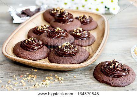 Chocolate cookies with ganache cream and hazelnut