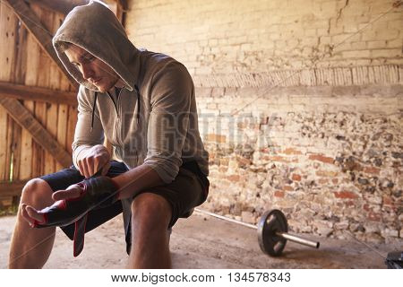 Young Male Boxer Training In Gym