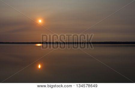 Sun rising near a lake that is in Saskatchewan Canada