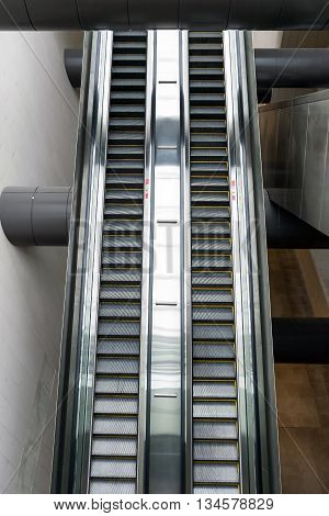 Closeup of the escalator in the big building.