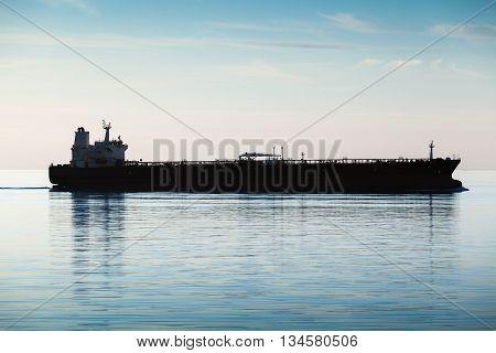 Big Industrial Tanker Ship Goes On Still Sea