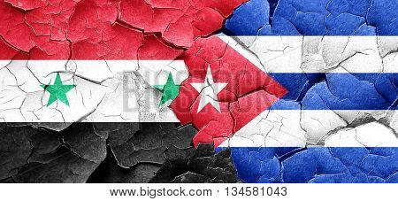 Syria flag with cuba flag on a grunge cracked wall