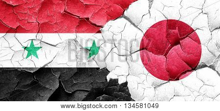 Syria flag with Japan flag on a grunge cracked wall