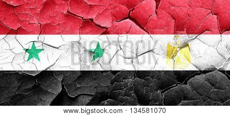 Syria flag with egypt flag on a grunge cracked wall