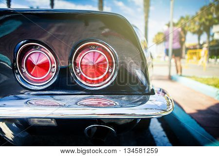 Benalmadena, Spain - June 21, 2015: Rear lights of black Chevrolet Corvette C3, parked in the port of Benalmadena (Spain), on June 21, 2015.