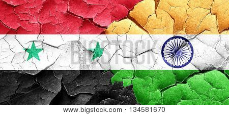 Syria flag with India flag on a grunge cracked wall