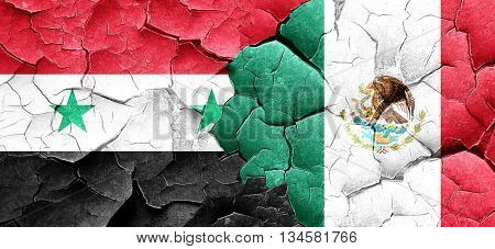 Syria flag with Mexico flag on a grunge cracked wall