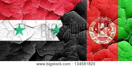 Syria flag with afghanistan flag on a grunge cracked wall