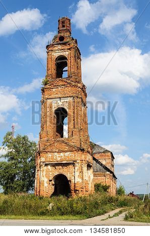 Old destroyed bell tower of Church of the Dormition in the village Voron'e Kostroma region Russia