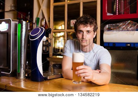 Bartender Serving Beer In A Pub