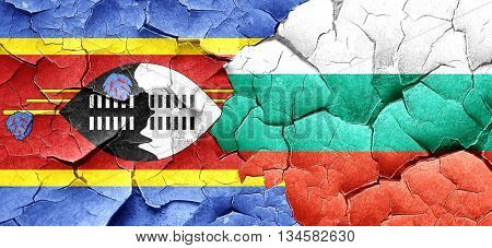 Swaziland flag with Bulgaria flag on a grunge cracked wall