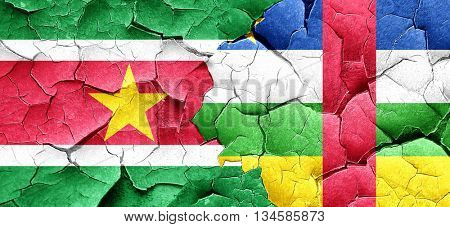 Suriname flag with Central African Republic flag on a grunge cra