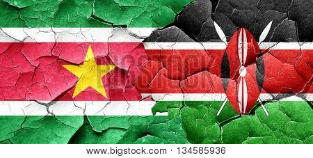 Suriname flag with Kenya flag on a grunge cracked wall