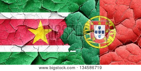 Suriname flag with Portugal flag on a grunge cracked wall