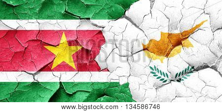 Suriname flag with Cyprus flag on a grunge cracked wall