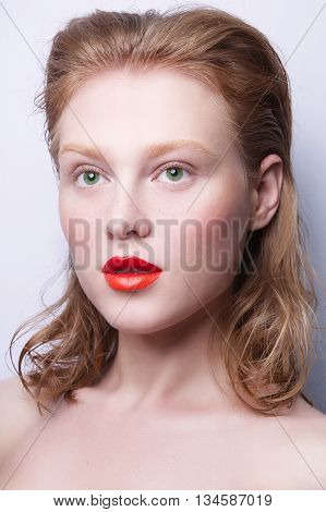 Beauty Fashion Model Woman face, perfect skin. Sexy Lips with different color. Woman with creative Makeup. bright natural brows, brown eyes, frickles . Beauty Cosmetic Concept Girl bright Background