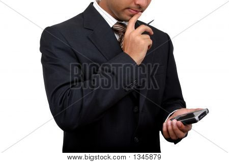 Indian Business Man Using Pda (3) With Clipping Path