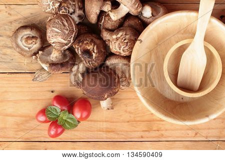 Shiitake mushrooms for cooking on wood background