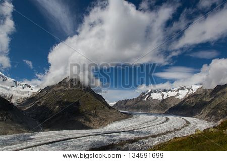 Glacier Aletsch with blue sky and clouds