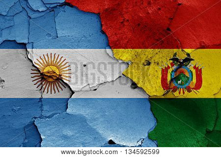 Flags Of Argentina And Bolivia Painted On Cracked Wall