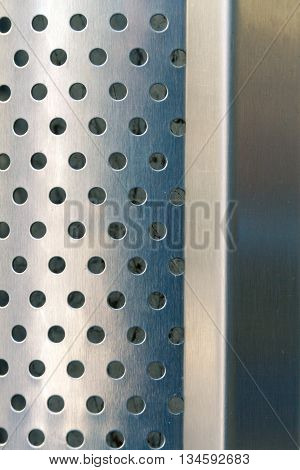Steel sheet perforated and wavy with smooth surface