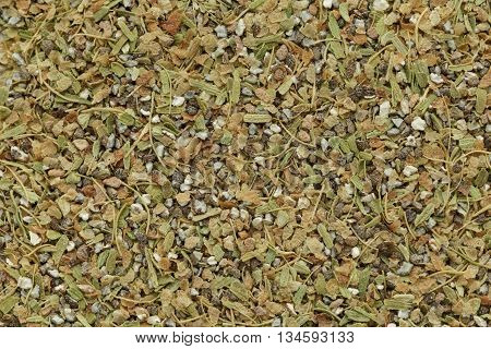 Organic dry True green cardamom (Elettaria cardamomum) tea cut seeds. Macro close up background texture. Top view.