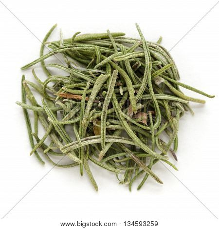Organic rosemary (Rosmarinus officinalis) leaves isolated on white background. Macro close up. Top view.