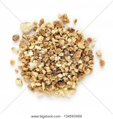 Organic dry sweet orange (Citrus sinensis) tea cut seeds isolated on white background. Macro close up. Top view.