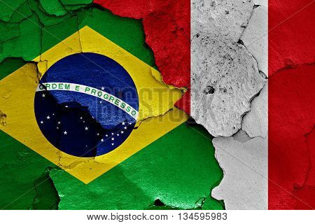 Flags Of Brazil And Peru Painted On Cracked Wall