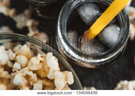 misted bottles of Cola with ice and fresh kettle corn